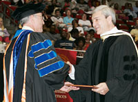 Geoffroy congratulations Graham Spanier, who received an honorary detree